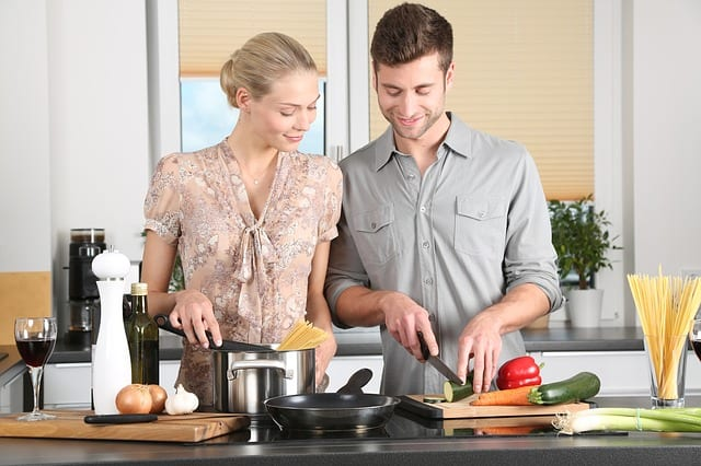 Happy couple in kitchen with refaced cabinets